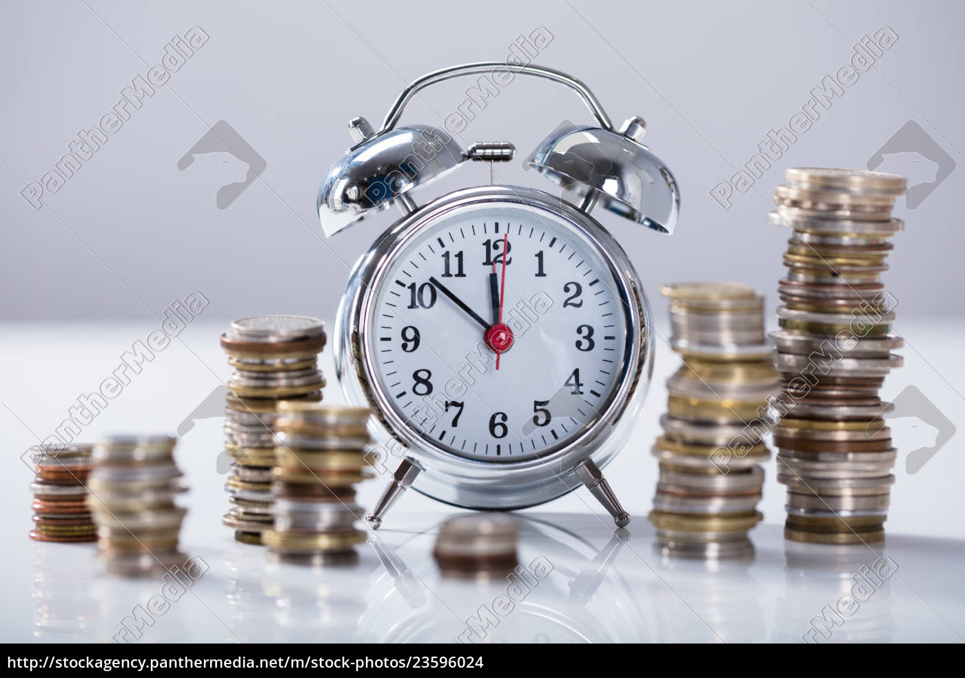 alarm, clock, with, stack, of, coins - 23596024