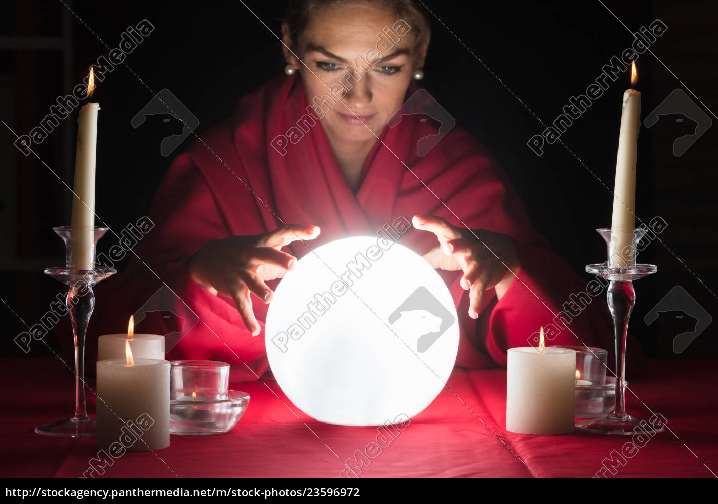fortuneteller, holding, hands, around, a, glowing - 23596972