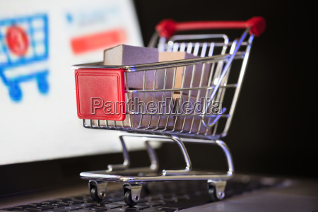 shopping cart with cardboard boxes
