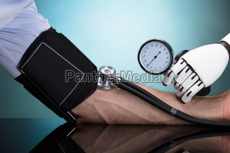 robot checking persons blood pressure