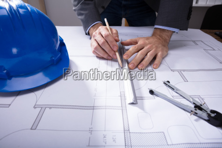 architecture's, hand, working, on, blueprint - 23597864