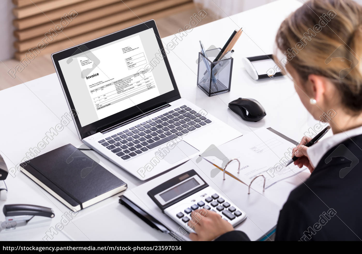 businesswoman, calculating, invoice, using, calculator, and - 23597034