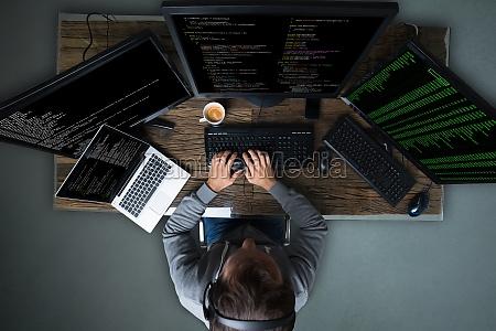 hacker, hacking, multiple, computers, on, desk - 23597792