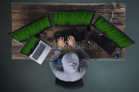 hacker, hacking, multiple, computers, on, desk - 23597800