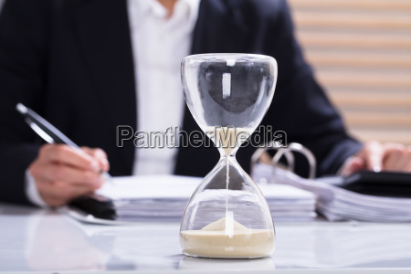 hourglass, with, businesswoman, calculating, bill - 23597006