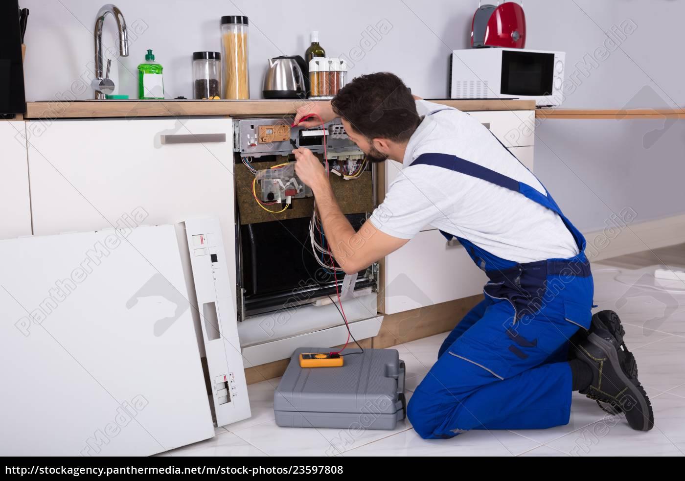 male, technician, examining, dishwasher - 23597808