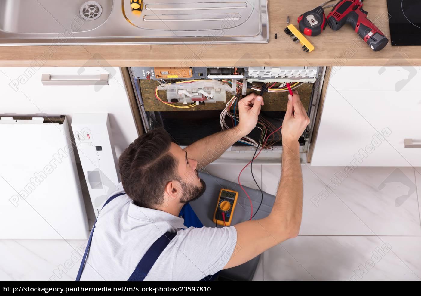male, technician, examining, dishwasher - 23597810