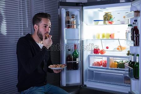 man, eating, cookie - 23597736
