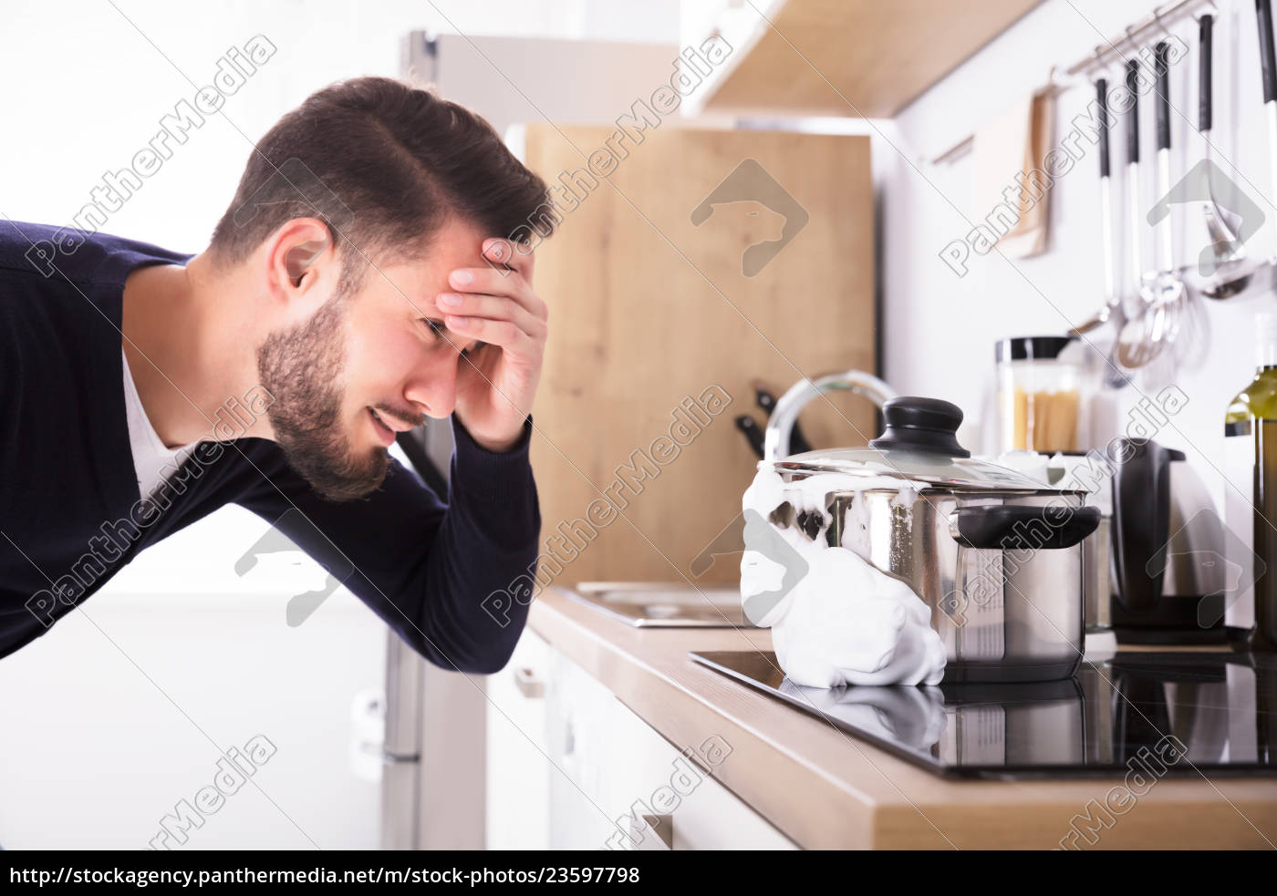 man, looking, at, spilling, out, boiled - 23597798