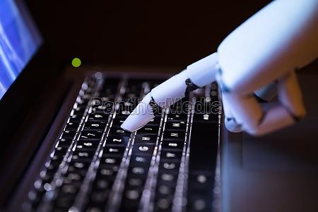 robot, typing, on, laptop - 23597908