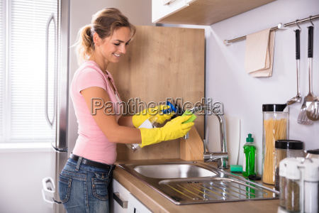 woman, cleaning, sink, tap, in, the - 23597112