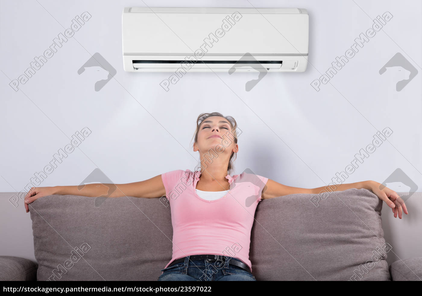 woman, relaxing, under, the, air, conditioner - 23597022