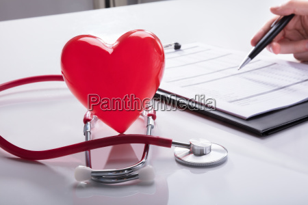 close up of stethoscope and red