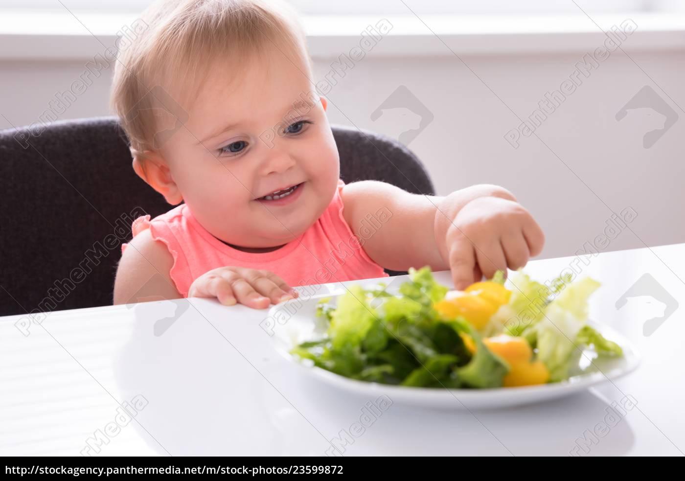 baby, girl, eating, vegetable - 23599872
