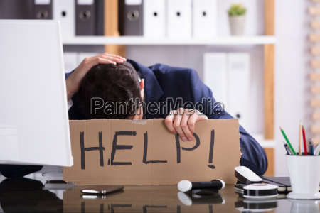 businessman, holding, cardboard, with, help, text - 23599778