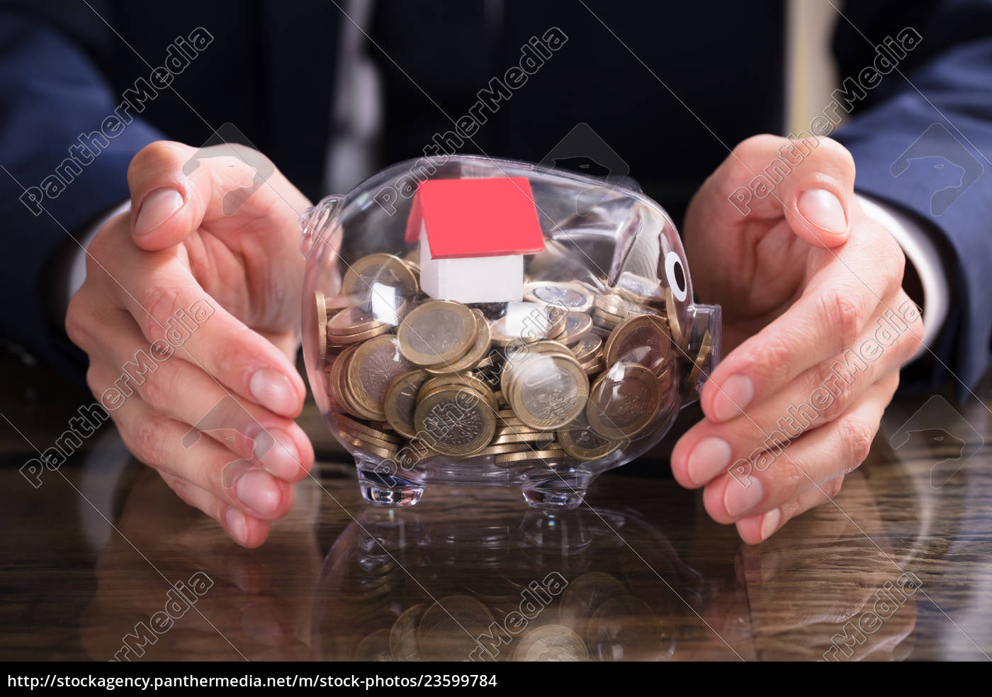 businessperson, protecting, house, model, and, coins - 23599784