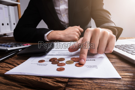 businessperson's, hand, counting, coins - 23599994
