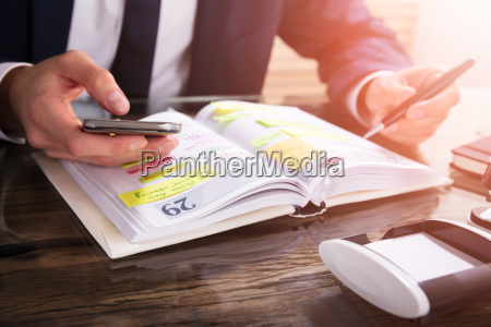 businessperson, using, mobile, phone - 23599782