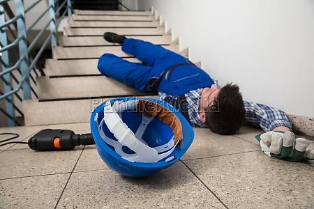 handyman, lying, on, staircase - 23599850