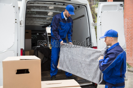 two, male, worker, unloading, furniture, from - 23599816