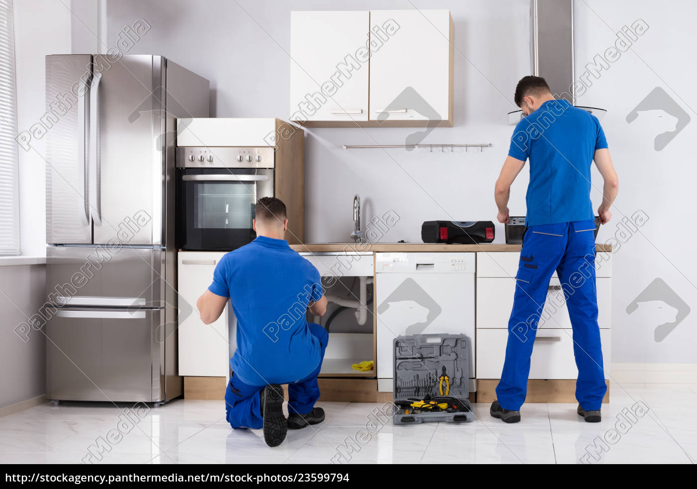 two, men, checking, induction, stove, and - 23599794