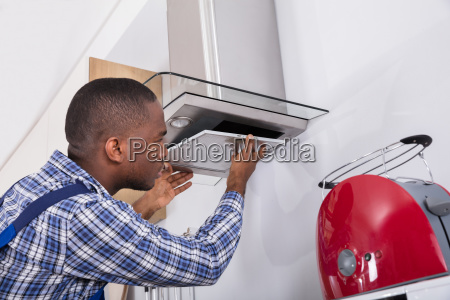 african, male, fixing, kitchen, extractor, filter - 23600772