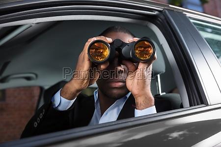 african, man, looking, through, binocular - 23600746