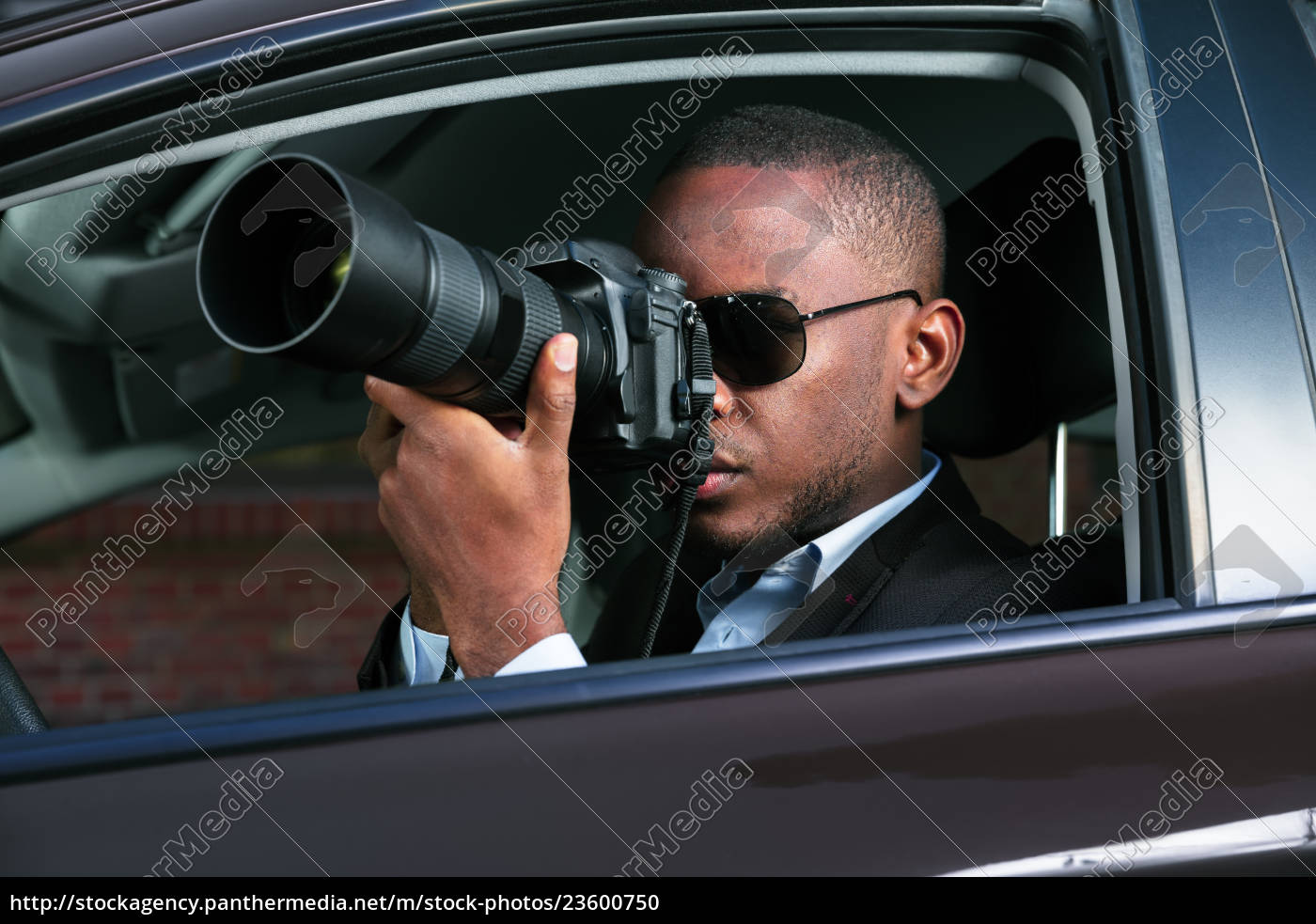 detective, sitting, inside, car, photographing - 23600750