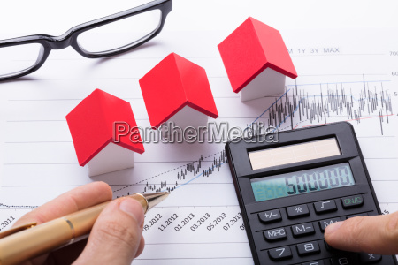 hand, calculating, financial, chart, with, calculator - 23600702