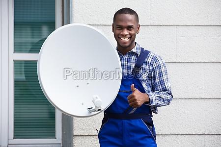 happy, male, technician, with, tv, satellite - 23600762