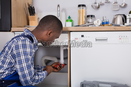 male, plumber, fixing, sink, pipe - 23600730