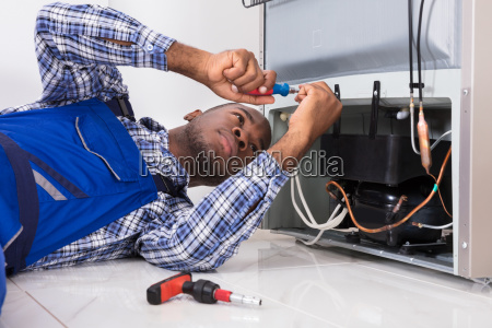 male, serviceman, working, on, fridge, with - 23600764