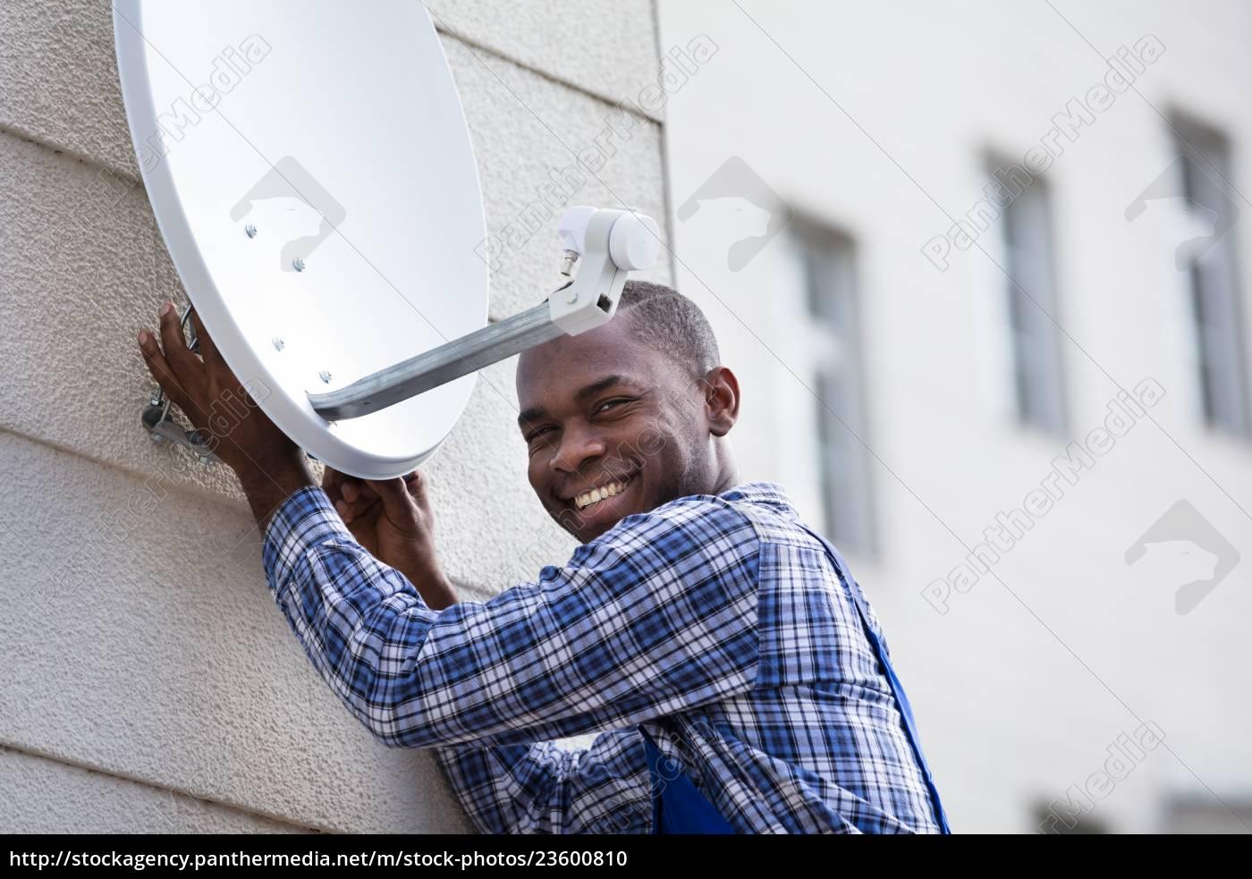 man, in, uniform, fitting, tv, satellite - 23600810
