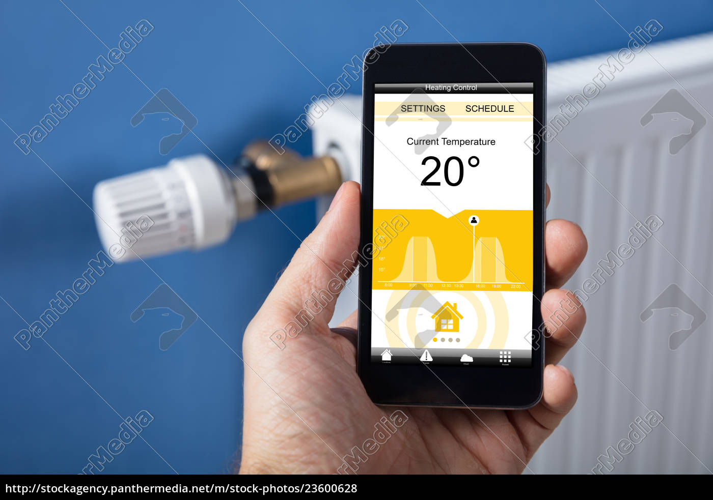 person, hand, setting, temperature, of, thermostat - 23600628