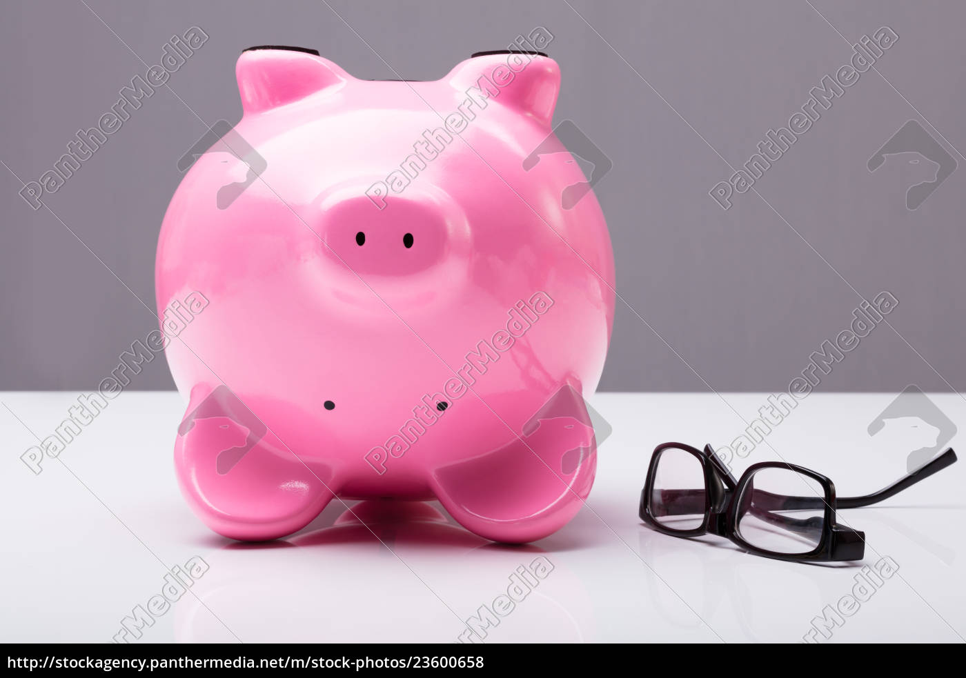 upside, down, piggy, bank, on, table - 23600658