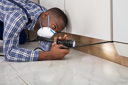 worker, with, mask, kneeling, on, floor - 23600808