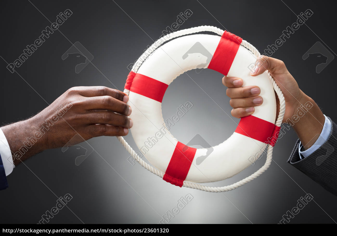businesspeople, holding, a, lifebuoy, in, hands - 23601320