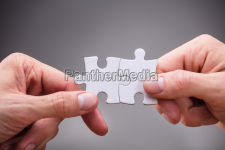 close-up, of, businesspeople, holding, jigsaw, puzzle - 23601454
