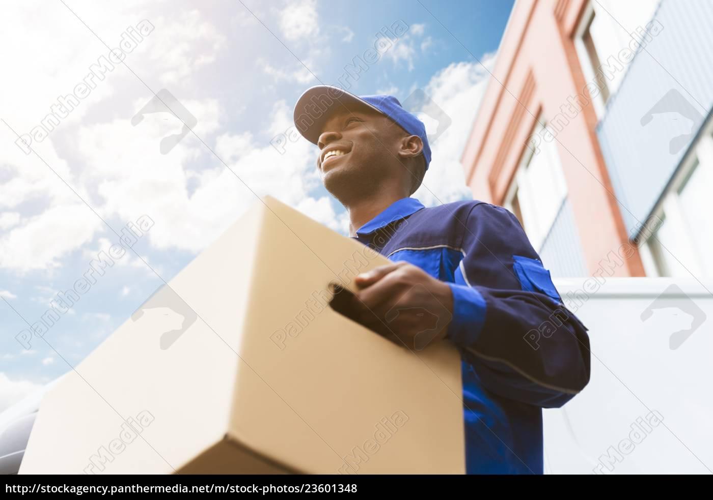 loader, man, with, cardboard, box - 23601348
