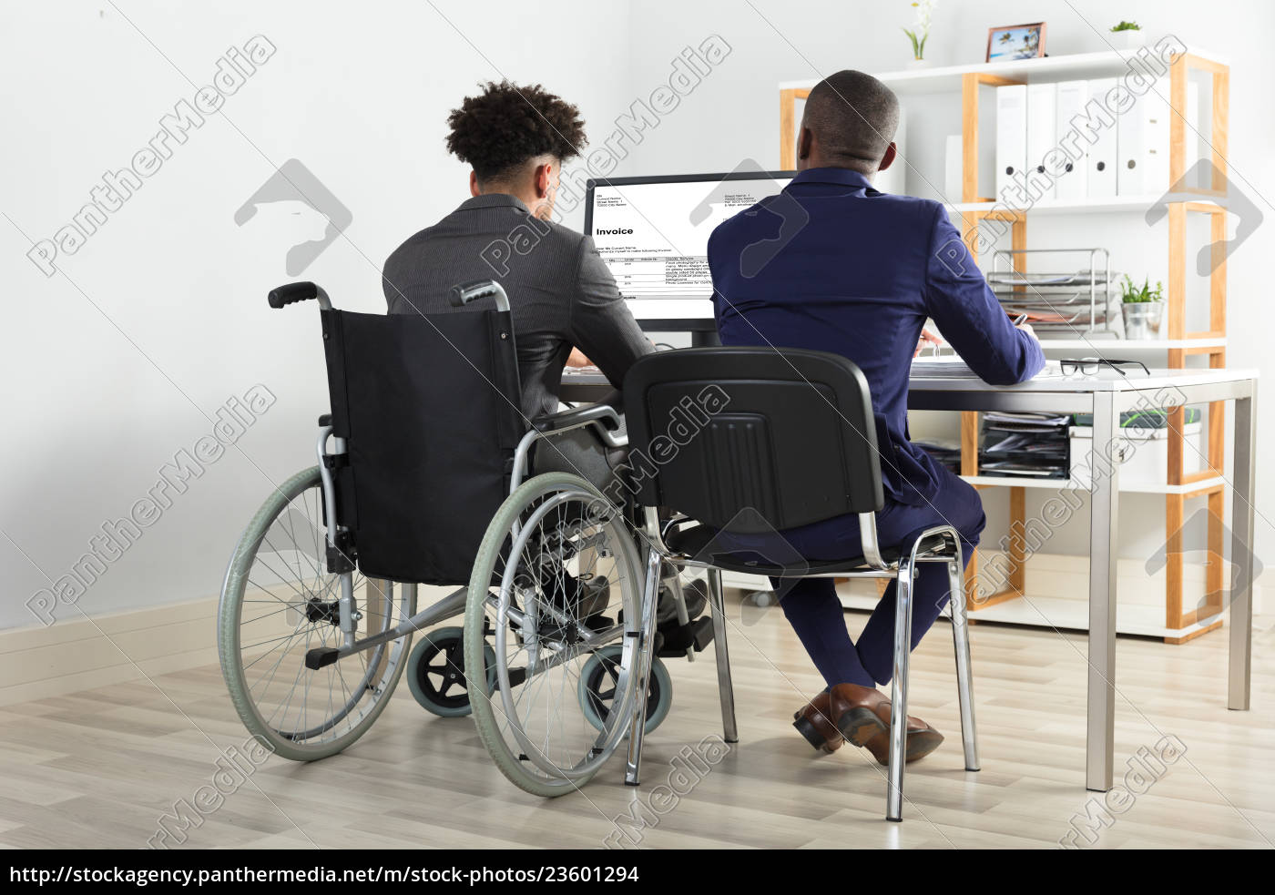 physically, impaired, businessman, with, his, partner - 23601294