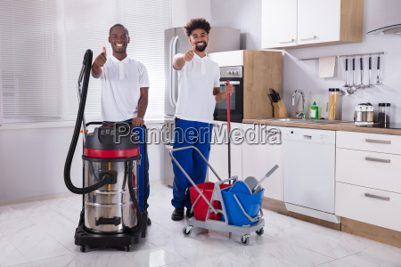 portrait, of, two, happy, male, janitor - 23601338