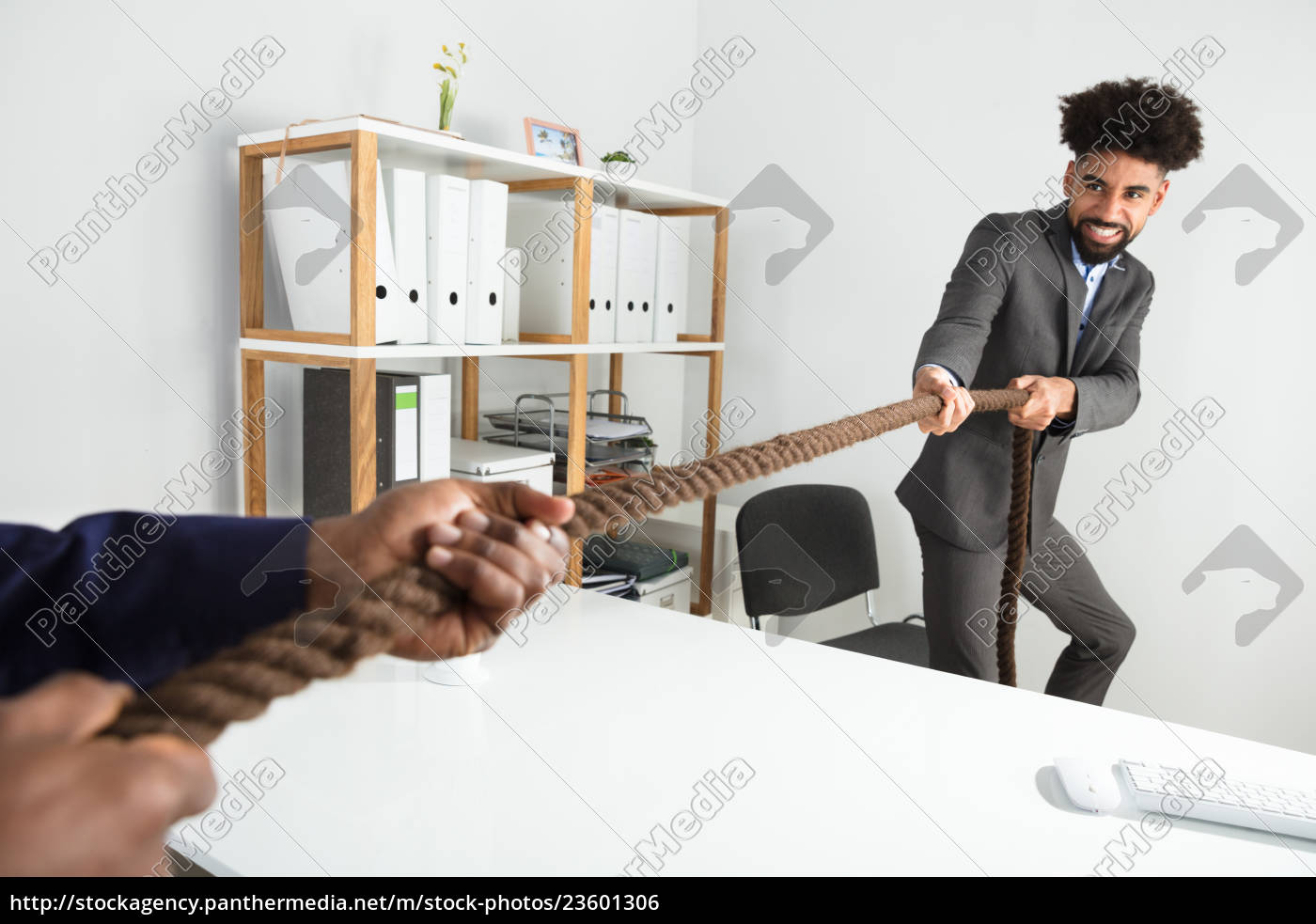 two, businessmen, playing, tug, of, war - 23601306