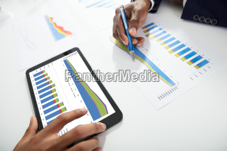 two, businesspeople, using, digital, tablet, while - 23601270