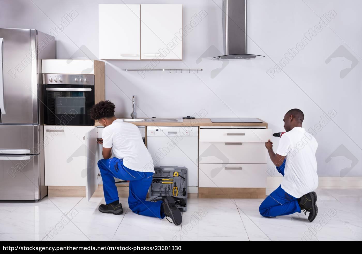 two, handy, men, fixing, the, wooden - 23601330