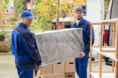 two, male, worker, unloading, furniture, from - 23601392