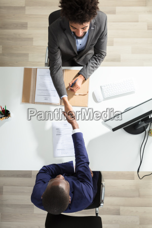 young, businessman, shaking, hand, with, candidate - 23601304