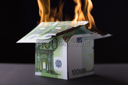 house made up of banknote burning