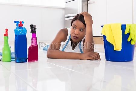 woman, lying, on, kitchen, floor, looking - 23602194