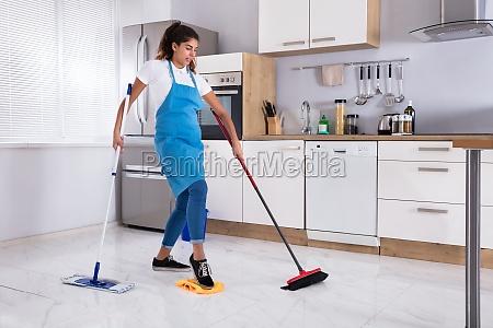 female janitor multitasking