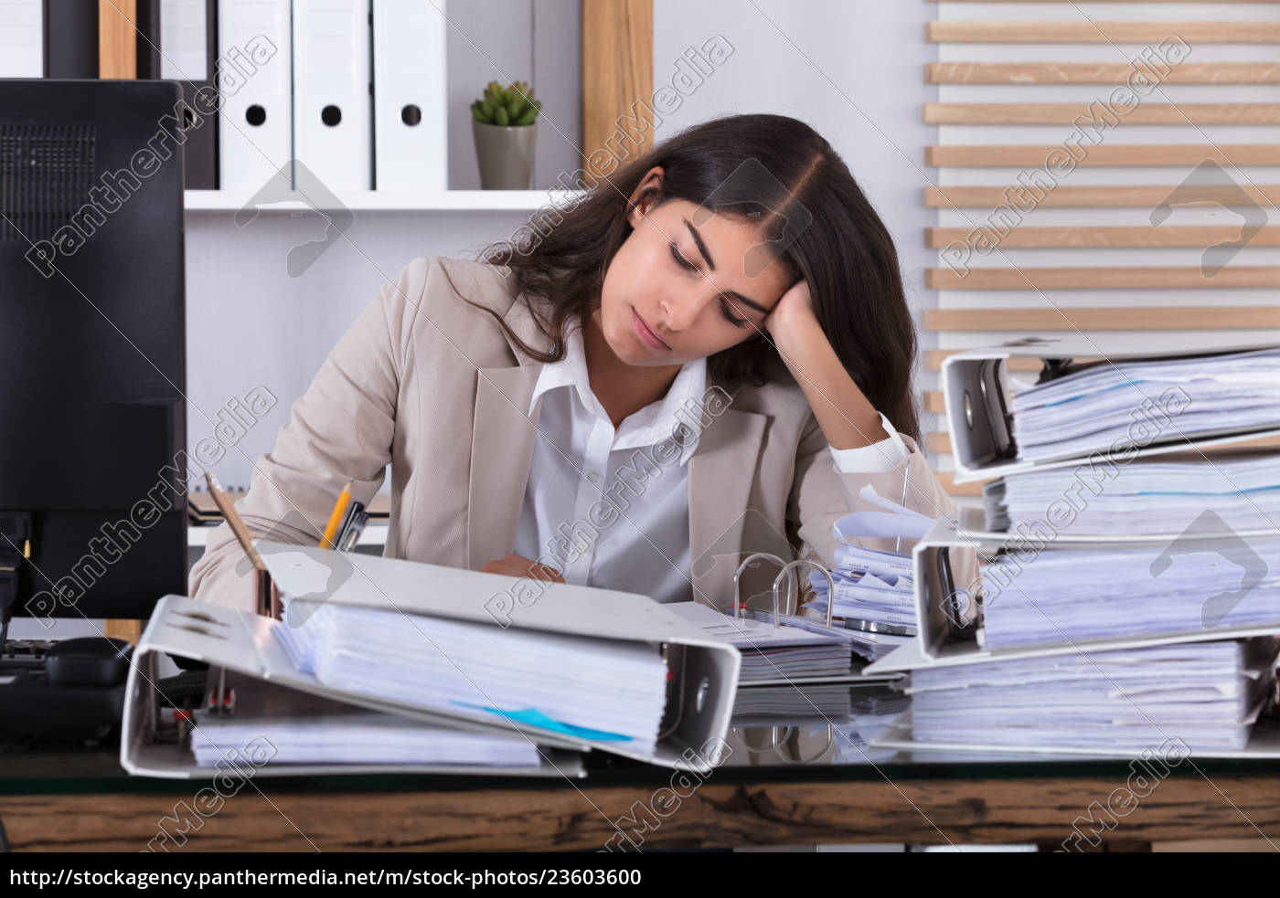 businesswoman, working, at, office, with, stack - 23603600